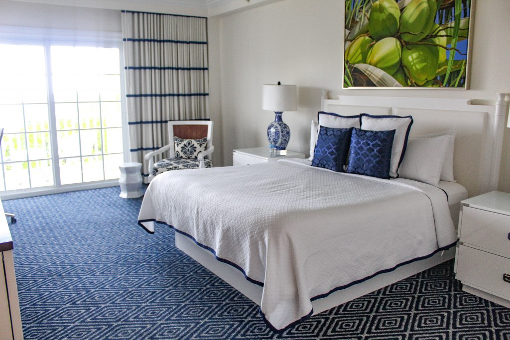 Blue carpet and crisp white linens in the rooms at Oceans Edge Resort and Marina Stock Island, Florida