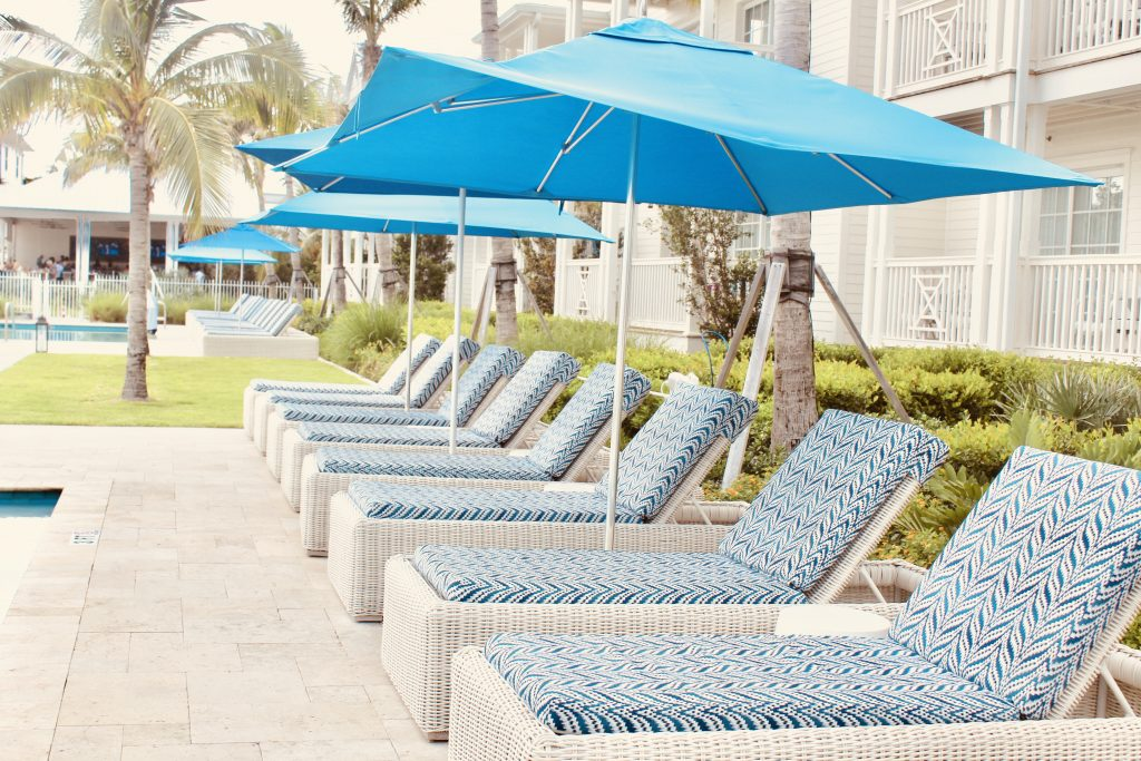Pool side loungers at the Oceans Edge Resort and Marina Stock Island, Florida