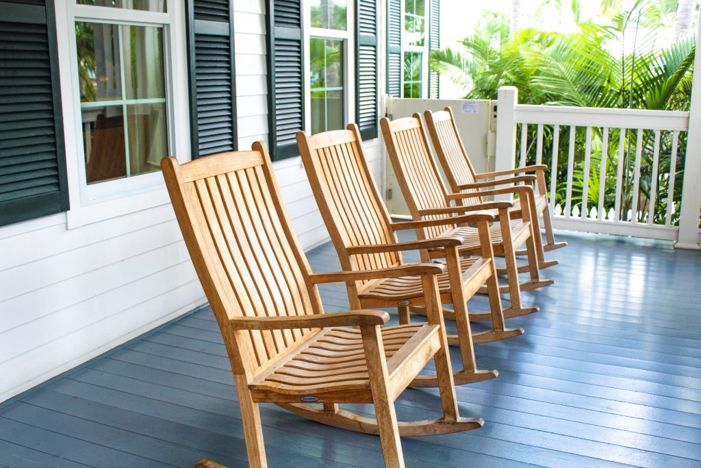rocking chairs on the front porch of Oceans Edge Resort and Marina Stock Island, Florida