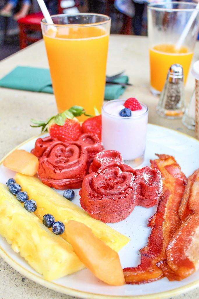 aulani character breakfast at Makahiki plate and passion orange guava juice