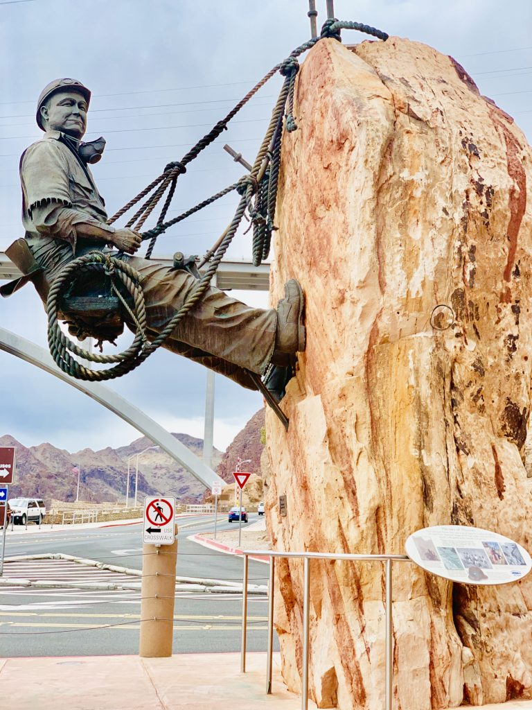hoover dam construction statue